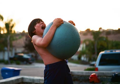 boy screaming w yoga ball